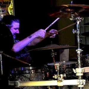Drummer, Andrew Hewett