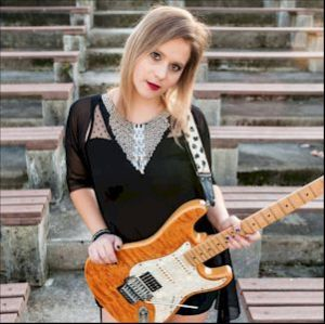 She comes from the Udine – North Italy near Slovenia. Her vibrant guitar-play is noted for its funkiness. 'Just for Me' buzzes and rattles in all the right places. Photo by Giordano Sala