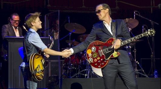 Toby Lee shaking hands with Joe Bonamassa